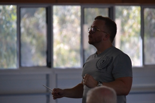 Adam Conducting